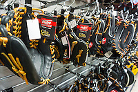 A display of Rawlings brand baseball gloves in a sporting goods store in New York on Wednesday, December 7, 2016. Due to declining participation in team sports by youth sales of sporting goods have hit record lows. The six to 17 year old demographic veers toward technology and video games.Newell Brands is reported to be interested in selling its Rawlings brand.  (© Richard B. Levine)