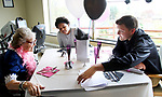 TORRINGTON CT. 25 April 2017-042517SV04-From left, Norma Rideout has lunch with Katiusca Delacruz, 16, of Torrington and Noah Weik, 16, of Litchfield during a senior prom where 18 students from Oliver Wolcott Tech. visited seniors at RegalCare at Torrington Tuesday.<br /> Steven Valenti Republican-American