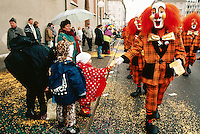 "Switzerland. Basel. Fasnacht Carnival. A group of persons from a  ""clique"" disguised in clowns walk on the road during the afternoon parade. A ""clique""  is a group of persons playing music in the streets during the three days of the Fasnacht Carnival. © 1997 Didier Ruef"