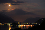 View of Lake Como, Italy at night with a full moon. View of Bellagio, Italy on Lake Como at night.