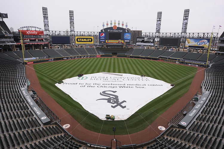 CHICAGO-IL: A rain tarp covers he field at U.S. Cellular Field during a rain delay on April 15, 2011. (Photo by Ron Vesely)