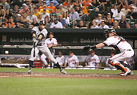 Ichiro Suzuki #51 of the Seattle Mariners attempts a bunt in front of Matt Weiters #32 of the Baltimore Orioles during a MLB game at Camden Yards, on August 8 2010, in Baltimore, Maryland. Orioles won 5-4 in extra innings.