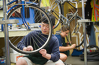 Dale Lee, left, and Jordan Taylor, both class of 2017, clean rust off of bike rims while working with Bike Recycle Vermont in Burlington.