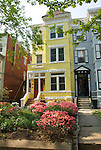 Washington DC; USA: Dupont Circle area, noted for its fountain, street musicians, bookstores, shops, embassies, and brick houses.  Lovely yellow brick house with azaleas on Kalorama..Photo copyright Lee Foster Photo # 21-washdc79695