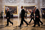 President Barack Obama  walks through the US Capitol Rotunda after they were sworn-in for a second term during the presidential inauguration, January 21, 2013.