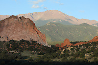 Gray Rock (left) and South Gateway Rock (right), with the Manitou Springs incline behind and Pikes Peak above, at the Garden of The Gods, an area of geological rock formations protected as a public park, near Colorado Springs, Colorado, USA. The formations are the result of vertical tilting due to the uplift forces of the Rocky Mountains and the Pikes Peak massif, of the horizontal layers of sandstones, conglomerates and limestones, resulting after erosion in the formation of fins and pinnacles. Native Americans have visited the area since 1330 BC and camped here since 250 BC, sheltering under the cliffs and producing rock art. The Garden of the Gods was listed as a National Natural Landmark in 1971. Picture by Manuel Cohen