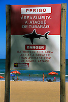 Bilingual Portuguese - English sign saying: Danger area subject to shark attack, at Boa Viagem Beach, Recife, Pernambuco, Brazil