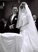 Catholic wedding ceremony, black and white image.  Fine art, journalistic wedding photograph / photography by German Silva.  Los Angeles, Southern California.