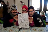 Roma 28 Dicembre 2011.Centro diurno per senzatetto 'Binario 95' in via Marsala 95, Famiglia ospite del centro.Day center for homeless people  'Track 95', Via Marsala, A family housed in the center.