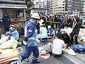Devastation After M8.9 Earthquake Struck Japan. People Wait for Assistance Outside Tokyo Kudankaikan After The Roof Collapsed on March 11th, 2011
