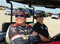 Sept. 22, 2012; Ennis, TX, USA: NHRA funny car driver Cruz Pedregon (near) with his brother Tony Pedregon during qualifying for the Fall Nationals at the Texas Motorplex. Mandatory Credit: Mark J. Rebilas-