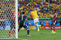 Thiago Silva of Brazil scores a goal to make the score 1-0