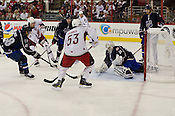 Daniel Briere, Keith Yandle, and Brent Burns of Team Lidstrom defend against Kris Letang, Jeff Skinner, and Patrick Elias of Team Staal. Tim Thomas of Team Lidstrom is in goal.