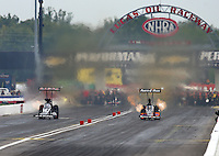 Aug 30, 2014; Clermont, IN, USA; NHRA top fuel dragster driver Clay Millican (right) races alongside Billy Torrence during qualifying for the US Nationals at Lucas Oil Raceway. Mandatory Credit: Mark J. Rebilas-USA TODAY Sports