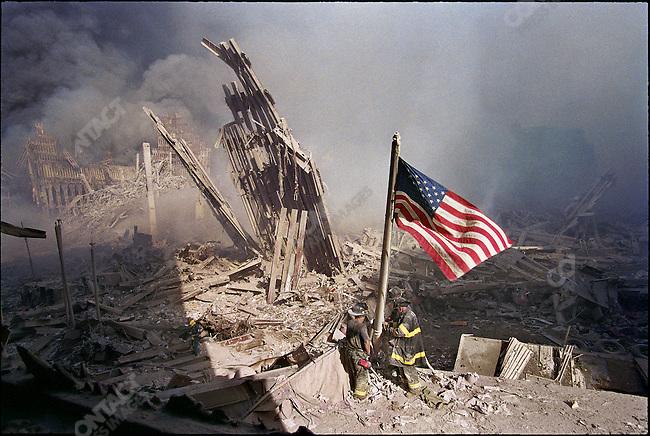Attack on the World Trade Center, view from Two World Financial Center, firefighters George Johnson, Dan McWilliams and Billy Eisengrein raising the American flag at Ground Zero, New York City, New York, USA, September 11, 2001