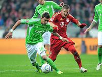 FUSSBALL   1. BUNDESLIGA  SAISON 2011/2012   19. Spieltag FC Bayern Muenchen - VfL Wolfsburg      28.01.2012 Mario Mandzukic (li, VfL Wolfsburg) gegen Bastian Schweinsteiger (FC Bayern Muenchen)