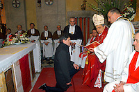 Rome February 5  2006  .Church of S.Agata in Trastevere.Gianni Alemanno becomes honorary brother of the venerable.confraternity of the ss. Sacramento and  Maria ss. of the carmine in Trastevere receives the   medallion with the insignias of the  confraternity from Mons. Ernesto Mandara, auxiliary bishop of Rome  downtown