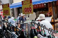 Sale price displays at shops along Jizo Dori shopping street in Sugamo, Tokyo, Japan. Friday, August 14th 2009. Sugamo is affectionately known as the old lady Harajuku, in reference to the Mecca for youth fashions in the South of Tokyo, and is a popular place for Tokyo's increasingly aged population.