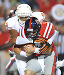 Mississippi quarterback Bo Wallace (14) is sacked by Texas' Jackson Jeffcoat (44) at Vaught-Hemingway Stadium in Oxford, Miss. on Saturday, September 15, 2012. (AP Photo/Oxford Eagle, Bruce Newman)
