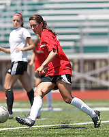 Aztec MA defender Carson Laderoute (24) passes the ball. In a Women's Premier Soccer League (WPSL) match, Aztec MA defeated CFC Passion, 4-0, at North Reading High School Stadium on July 1, 2012.