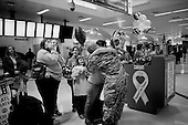 Atlanta, Georgia.USA.March 12, 2007..Sgt. Michael Olsen arrives home in the United States at the Atlanta airport after a tour of duty in Iraq. He greets his wife Amy Olsen, and children Roberta (10) Shelby (16) and Stephanie (12) and Brittany (14).