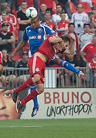 03 July 2013: Montreal Impact defender Matteo Ferrari #13 and Toronto FC forward Jeremy Brockie #22 in action during an MLS game between the Montreal Impact and Toronto FC at BMO Field in Toronto, Ontario Canada.<br /> The game ended in a 3-3 draw.