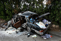 near Qana,  Lebanon, Aug 4 2006.An Israeli missile hit two civilian cars on a mountain road, killing their occupants as they were fleeing their villages under attack..