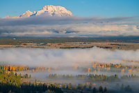 Teton National Park, Wyoming:<br /> Lingering fog in the Snake River valley with the Mount Moran in morning light