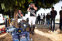 Western Australia Polo Team players take a quick break between chukkars during a game between the Royal Jaipur Polo Team and the Western Australia Polo Team for the Argyle Pink Diamond Cup, organised as part of the 2013 Oz Fest in the Rajasthan Polo Club grounds in Jaipur, Rajasthan, India on 10th January 2013. Photo by Suzanne Lee