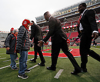 "Grant Reed, 13, (front) and Collin Reed, 9, (back) of Bellville high-fives Ohio State Buckeyes players at midfield before their game against Penn State Nittany Lions at Ohio Stadium on October 26, 2013.   Grant, who nicknamed his cancer ""Michigan"" and beat it.  In May 2012, Grant underwent a 16 1/2-hour surgery to have his brain tumor removed. (Dispatch photo by Kyle Robertson)"
