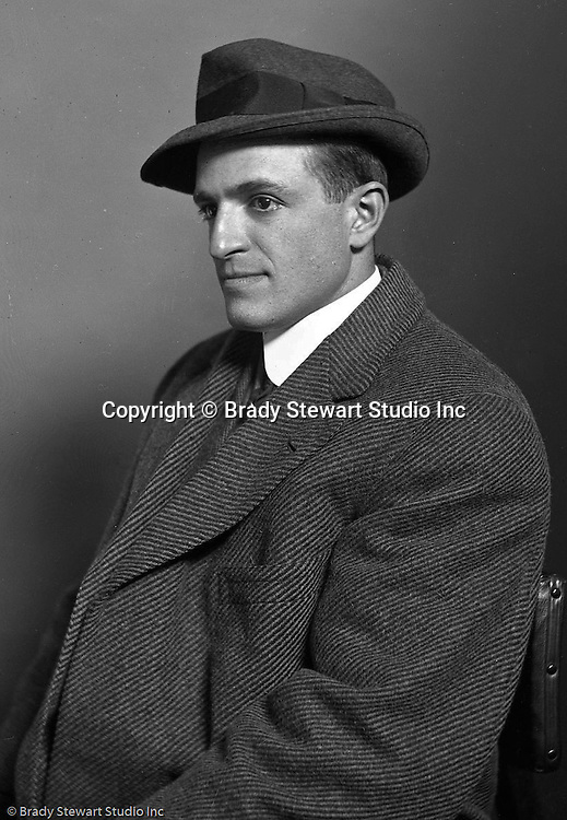 Wilkinsburg PA:  View of Brady Stewart sitting for a portrait in his home studio - 1912.  Brady Stewart opened B.W. Stewart Studio in 1912 and the initial business focus was on portraits.