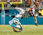Atlanta Falcons fullback Patrick DiMarco (42) is upended by Miami Dolphins cornerback Bobby McCain (28) in the second quarter during the Miami Dolphins' exhibition game against the Atlanta Falcons at Sun Life Stadium on Saturday, August 29, 2015.
