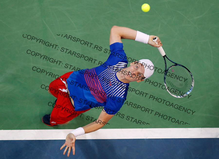 BELGRADE, SERBIA - NOVEMBER 15: Tomas Berdych of Czech Republic serves the ball against Dusan Lajovic of Serbia during the day one of the final Davis Cup match between Serbia and Czech Republic on November 15, 2013 in Belgrade, Serbia. (Photo by Srdjan Stevanovic)