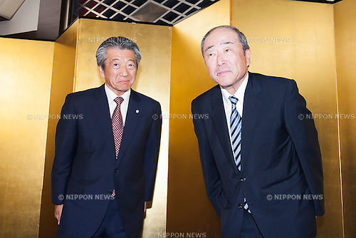 (L to R) Tsuyoshi Kameoka Representative Director, President, Group CEO of Showa Shell Sekiyu K.K. and Takashi Tsukioka Representative Director & Chief Executive Officer of Idemitsu Kosan Co Ltd. attend a news conference to announce the Idemitsu company's plans to buy a 1/3 stake in Showa Shell Sekiyu from Royal Dutch Shell at the New Otani Hotel on July 30th, in Tokyo, Japan. Idemitsu Kosan is currently Japan's second biggest oil refiner with Showa Shell ranked fifth. Idemitsu Kosan will pay approximately $1.4 billion for the stake, and the deal should see it competing for the number one spot in the competitive Japanese market. Shell will retain a small stake in Show Shell and will benefit from the influx of capital. Pending approval the deal is expected to be complete in 2016. (Photo by Rodrigo Reyes Marin/AFLO)