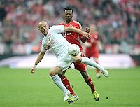 FUSSBALL   1. BUNDESLIGA  SAISON 2011/2012   31. Spieltag FC Bayern Muenchen - FSV Mainz 05       14.04.2012 Elkin Soto (li, 1. FSV Mainz 05) gegen David Alaba (FC Bayern Muenchen)