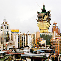 The Grand Lisboa casino and hotel during its construction. It is shaped like a lotus flower and on opening had more than 400 rooms and a 24 hour casino featuring 240 gaming tables.