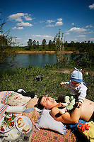 A policeman, Dan Chirisa, and his family picnic by the Dnister (Nistru) River.