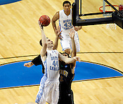 Tyler Zeller makes a layup in the first half. Zeller led the Tar Heels in scoring with 17 total points. UNC defeated Vermont 77-58 during the 2nd round of the 2012 NCAA Basketball Championship at the Greensboro Coliseum in Greensboro, NC. Photo by Al Drago.