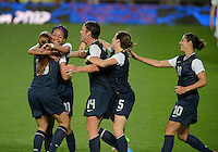 Manchester, England - Monday, August 6, 2012: The USA defeated Canada 4-3 in overtime in the semi-final round of the 2012 London Olympics at Old Trafford. Alex Morgan is congratulated after the game.