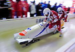 18 December 2010: Rush Lyndon pushes his 2-man bobsled for Canada, finishing in 5th place at the Viessmann FIBT World Cup Bobsled Championships on Mount Van Hoevenberg in Lake Placid, New York, USA. Mandatory Credit: Ed Wolfstein Photo