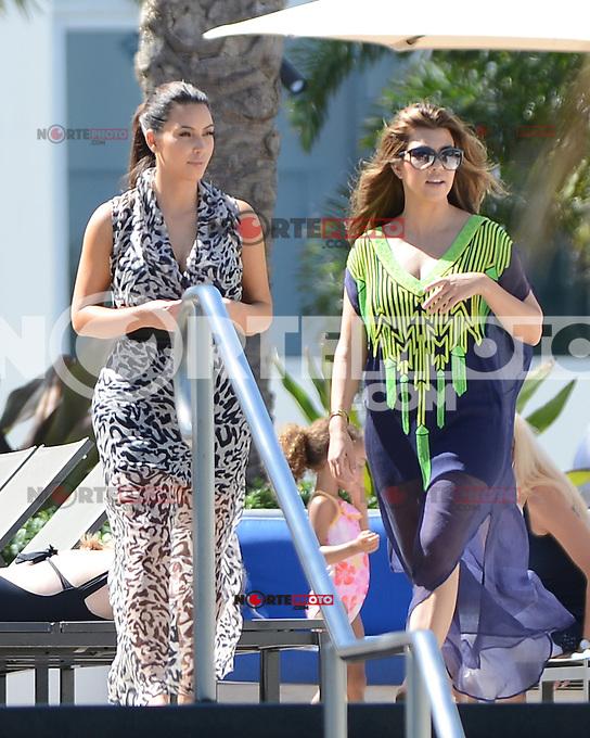 MIAMI BEACH, FL - OCTOBER 3: Kim Kardashian and  Kourtney Kardashian are sighted on October 3, 2012 in Miami Beach, Florida.©mpi04/MediaPunch Inc.. /©NortePhoto