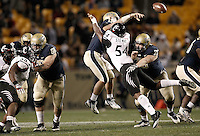 PITTSBURGH, PA - NOVEMBER 05: Tino Sunseri #12 of the Pittsburgh Panthers is hit while throwing by Walter Stewart #54 of the Cincinnati Bearcats on November 5, 2011 at Heinz Field in Pittsburgh, Pennsylvania.  (Photo by Jared Wickerham/Getty Images)
