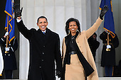 Washington, DC - January 18, 2009 -- United States President-elect Barack Obama and Michelle Obama wave to the crowd gathered at the Lincoln Memorial on the National Mall in Washington, D.C., Sunday, January 18, 2009, during the inaugural opening ceremonies.  More than 5,000 men and women in uniform are providing military ceremonial support to the presidential inauguration, a tradition dating back to George Washington's 1789 inauguration. .Credit: Mark O'Donald - DoD via CNP.
