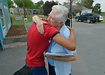 Edwin Chacon, an asylum seeker from Honduras, says goodbye to Sister Therese Cunningham at the Posada Providencia in San Benito, Texas. Chacon, 18, stayed at the shelter for several days after being released by immigration authorities pending a judicial hearing on his asylum request. He then flew on to stay with a relative elsewhere in the United States.<br /> <br /> Cunningham, originally from Ireland, is a member of the Sisters of the Holy Spirit.<br /> <br /> Sponsored by the Catholic Sisters of Divine Providence, the Posada Providencia provides a safe place for people in crisis from all over the world who are seeking legal refuge in the United States.