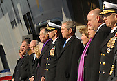 Norfolk, VA - January 10, 2009 -- Captain Kevin E. O?Flaherty, commanding officer of the aircraft carrier USS George H.W. Bush (CVN 77) stands between United States President George W. Bush, right, and former United States President George H.W. Bush as they stand with other dignitaries and their spouses during the commissioning ceremony for the aircraft carrier George H.W. Bush (CVN 77) at Naval Station Norfolk, Virginia..Credit: Demetrius Patton - U.S. Navy via CNP
