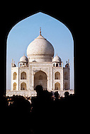 Agra, India, January 1975: Silhouette of visitors in front of the Taj Mahal located in Agra, India. Taj Mahal is a white marble mausoleum built by Mughal emperor Shah Jahan in memory of his third wife, Mumtaz Mahal. Taj Mahal is the finest example of Mughal architecture, a style that combines elements from Persian, Turkish and Indian architectural styles and also considered as one of the seven wonders of the world. In 1983, the Taj Mahal became a UNESCO World Heritage Site.