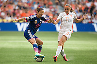 June 23, 2015: Yuki OGIMI of Japan controls the ball during a round of 16 match between Japan and Netherlands at the FIFA Women's World Cup Canada 2015 at BC Place Stadium on 23 June 2015 in Vancouver, Canada. Japan won 2-1. Sydney Low/AsteriskImages.com