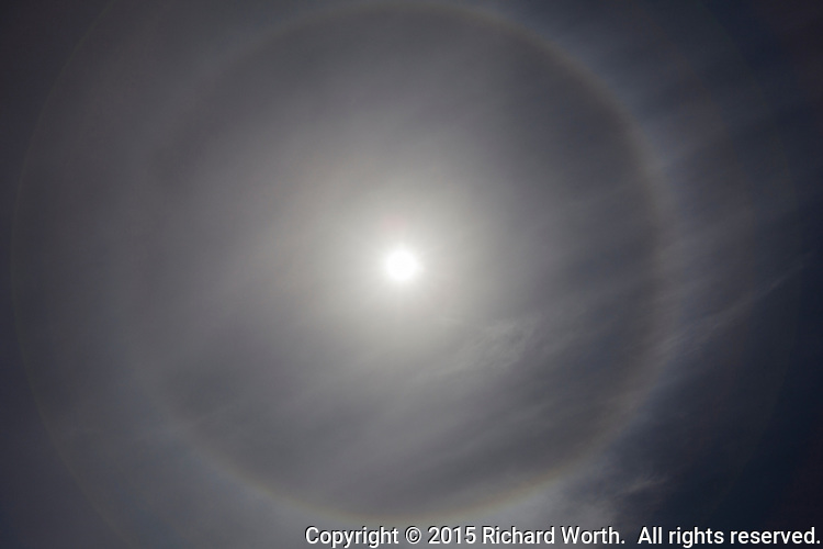 Ice crystals high in the sky are responsible for what are called 22-degree halos around the sun like this one photographed in the San Francisco Bay area.