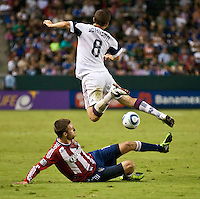 CARSON, CA – August 27, 2011: Chivas USA midfielder Blair Gavin (18) and Real Salt Lake midfielder Will Johnson (8) during the match between Chivas USA and Real Salt Lake at the Home Depot Center in Carson, California. Final score Chivas USA 0, Real Salt Lake 1.