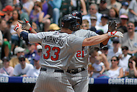Minnesota Twins 1st baseman Justin Morneau and outfielder Delmon Young (21) celebrate a two-run homerun hit by Morneau against the Colorado Rockies. The Rockies defeated the Twins 6-2 at Coors Field in Denver, Colorado on May 18, 2008. FOR EDITORIAL USE ONLY. FOR EDITORIAL USE ONLY